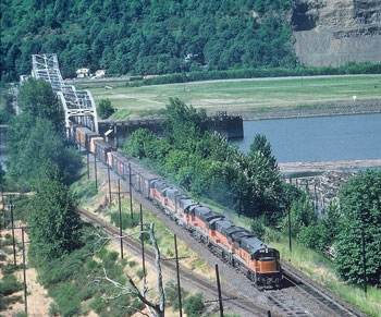 Milwaukee Road GEs haul the daily northbound freight across the Willamette River Swing Bridge